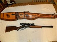 Western Field model 740A EMN 30 30 same Marlin 336 carbine  w/Weaver K4-60B scope & beautiful hand carved leather case.