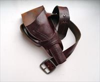 ENGRAVED LEATHER HOLSTER FOR A COLT SAA REVOLVER