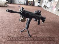 SIG 556 (piston operated)