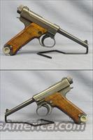 Nambu 8mm Pistol - Circa 1943 - Includes original holster, tool, and 2 magazines