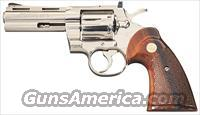 HIGHLY DESIRABLE COLT PYTHON WITH NICKEL FINISH AND 4 INCH RIBBED BARREL FROM 1975 !!