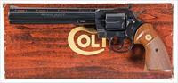COLT PYTHON IN SCARCE .38 SPECIAL, COLT BLUE FINISH AND 8 3/8 INCH VENT RIBBED BARREL. WOOD GRAINED BOX AND PAPERS.