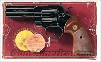 COLT PYTHON WITH 4 INCH BARREL, BLUE FINISH, NEW IN ORIGINAL WOOD GRAIN BOX