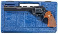 COLT PYTHON IN BLUE WITH 8 INCH BARREL & BLUE COLT CASE AND PAPERS. MANUFACTURED AFTER 1991.