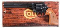 COLT PYTHON .38 SPECIAL IN COLT BLUE WITH HIGHLY DESIRABLE 8 INCH VENT RIBBED BARREL. COLT WOOD GRAINED BOX.