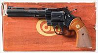 COLT PYTHON IN COLT BLUE WITH 6 INCH VENT RIBBED BARREL AND WOOD GRAIN BOX.