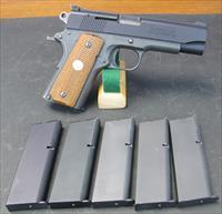 RARE COLT OFFICERS MODEL CONVERTED TO .22LR WITH CIENER CONVERSION AND FIVE 1O SHOT CIENER MAGAZINES.