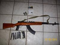 Like new SKS with AK 74 muzzle brake, 30 rd mag, and extended mag release
