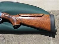 "Remington 1100 with 28"" VR barrel, screw chokes"