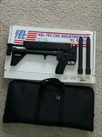 KelTec SUB 40 S&W with a Glock grip 1-15 and 2-29 rd mags and case