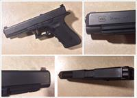 Glock 34 9mm Gen 4 with Trijicon HD sights and holsters