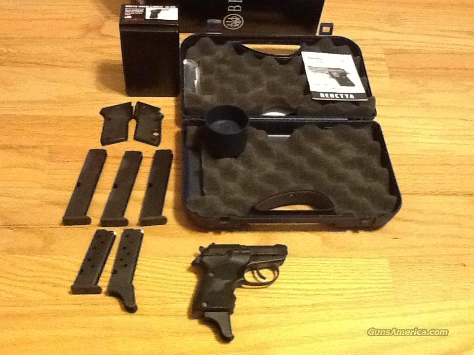 Beretta 3032 Tomcat in  32acp w/Crimsom Trace Laser Grips & 6 magazines  Like new