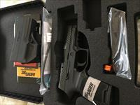 Sig P320. Night Sights, holster, and rail. New in Box