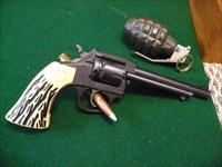 Iver johnson model 50A Sidewinder,loading gate needs repair,oversized western style plastic imitation Stag grips says in book new in 1968