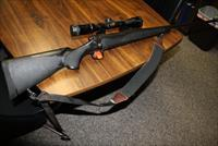 REMINGTON 700 SYNTHETIC .300 RUM WITH MUZZLE BREAK AND NIKON SCOPE