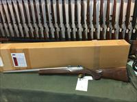 COOPER MODEL 38 .22 HORNET WITH BOX AND TARGET