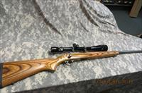 RUGER 77/22 MAGNUM ALL WEATHER STAINLESS WITH REDFIELD 8-32XAO SCOPE