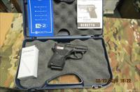 BERETTA TOMCA 32ACP WITH LASERGRIPS