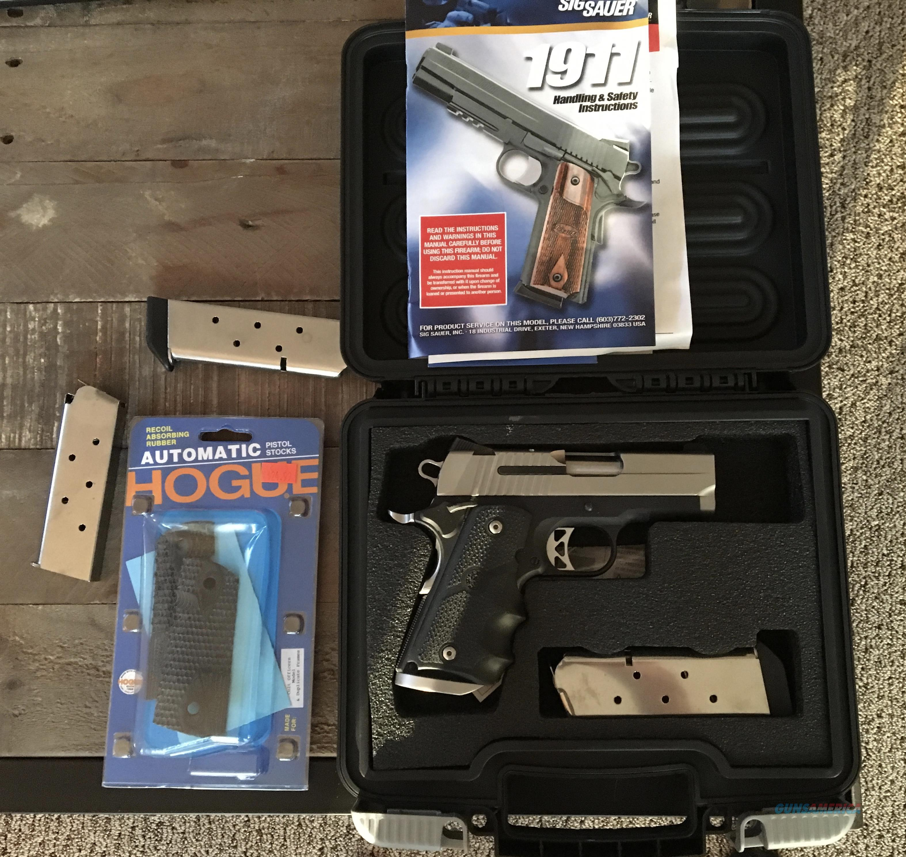 1911 model SIG SAUER stainless steel  45 caliber compact with custom grips  and dove tail/3 mags