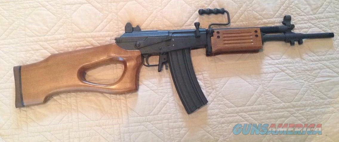 How hard would it be to swap out the thumb hole on a Galil