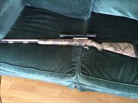 Thompson Center Omega  with a Bushnell 3x9 scope