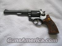 "Taurus 6""  .357 Magnum (blued with walnut grips)"