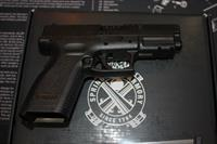 Springfield XD9 Defender with a 16 rd mag & a 32 rd magazine