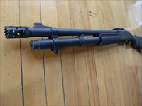 Remington 870 tactical with fancy device at end of barrel