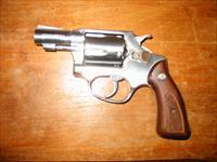 Like new Rossi stainless steel .38 special snub nose revolver