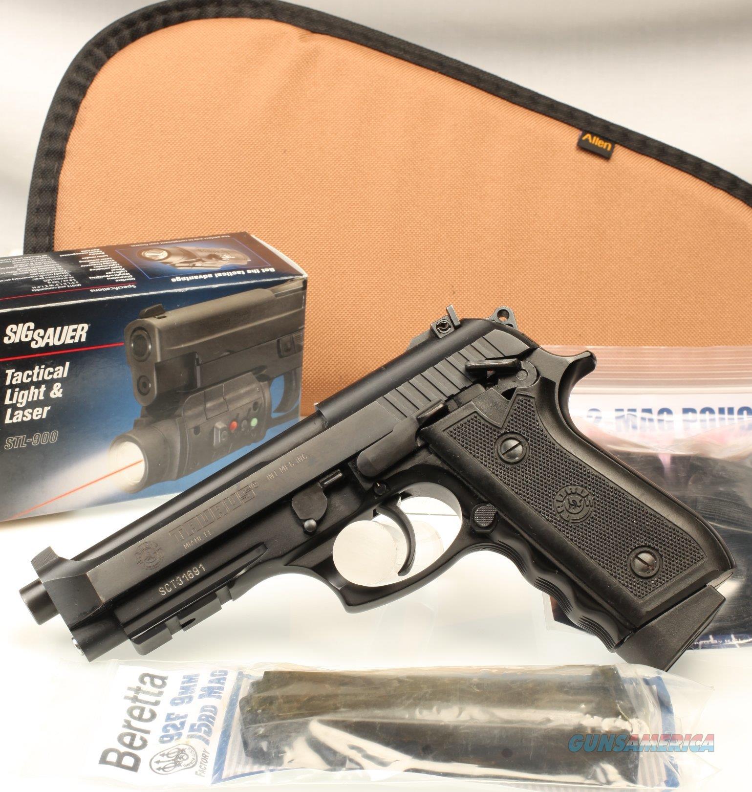 Taurus PT 101 F  40, black, as new, new laser sight + extras