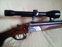 Fine, deluxe & hardly used HEYM Drilling in 30-06 & 2x 12/70 ga with claw mounted German scope