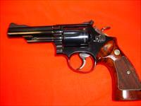 Smith and Wesson 19-3 4 inch blued Three Ts Excellent cond