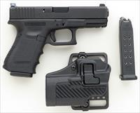 Glock Model 23 .40, Trijicon night sights, two 13-round magazines, Blackhawk! CQC holster