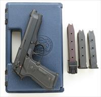 Beretta 92F 9mm, Crimson Trace Lasergrips, three 15-round & one 20-round factory magazines, case