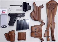 HK P7 PSP 9mm, unfired, five factory mags, tools, three holster systems