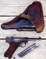 Luger 9mm with Nazi markings, holster, matching numbers