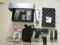 Sig. P2022, laser, holster,extra mag and nite sights