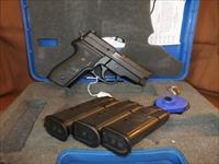 Sig P229 40 SW SLite with Night Sites and 3 12 Round Mags.