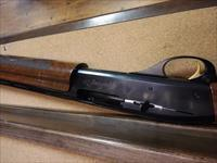 Remington 1100 sporting 20ga