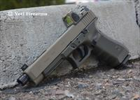 X-Werks Glock 34 G4 MOS 9mm Magpul FDE / OD RMR Trijicon RM06 3.25 MOA Red Dot Type 1 SilencerCo