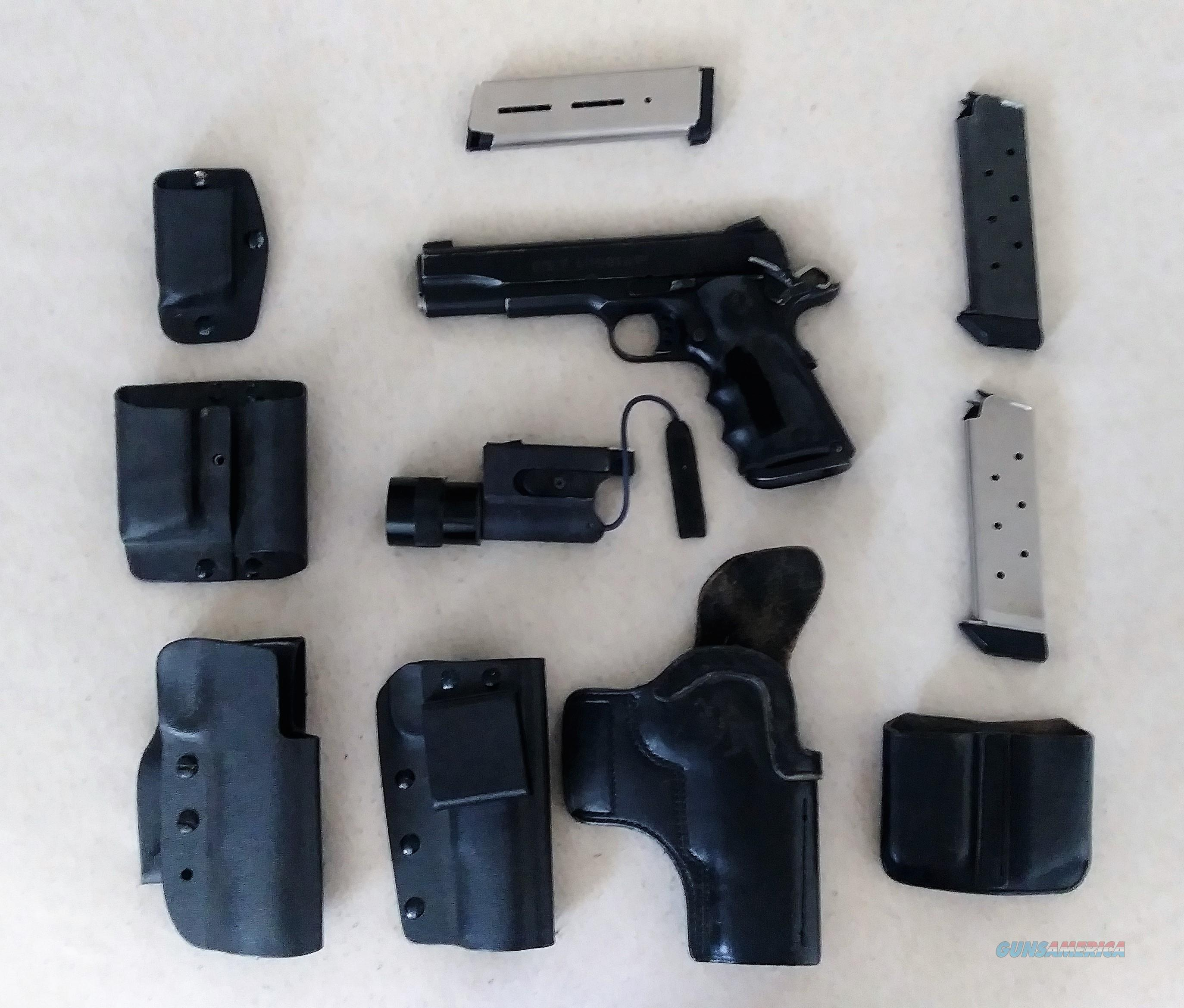 1911 Kydex and Leather Holsters, Mag pouches, Magazines, Surefire mounted  light