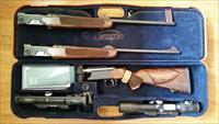 Krieghoff Semprio Rifle w/ .243 Win., .375 Ruger barrels. 2 scopes and carrying case