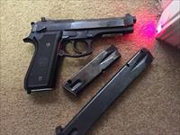 9 mm full sized classic handgun with laser bolt