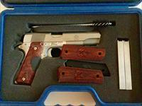 LIKE BRAND NEW STAINLESS STEEL S.A .45 WITH CRIMSON TRACE LASER GRIPS,CASE AND MANY ACCESSORIES