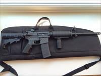 Bushmaster Carbon 15.  Never fired. $600