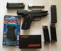 SIG P229 in .357 SIG with extra .40 threaded barrel with Crimson Trace grip