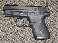 "S&W M&P -9 SHIELD WITH ""SNAKE EYE"" SIGHTS AND TWO MAGAZINES"