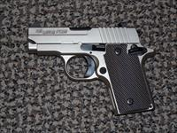 SIG SAUER P-238 IN NICKEL WITH VECTOR GRIPS AND NIGHT SIGHTS
