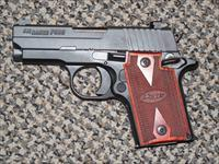 SIG SAUER P-938 IN 9 MM WITH ROSEWOOD GRIPS AND NIGHTSIGHTS