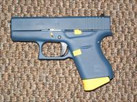 "GLOCK 9 MM MODEL 43  FINISHED IN ""NAVY"" BLUE AND YELLOW"
